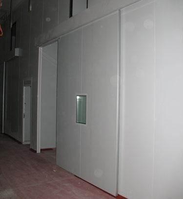 porte industrielle coulissante tc1 gamme conomique tane hermetic sp cialistes de la porte. Black Bedroom Furniture Sets. Home Design Ideas